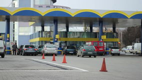 Fuelling at the Petrol Pump. Footage can be used for a wide range of subjects regarding the petrol price increase, fossil combustibles crisis, environmental stock footage