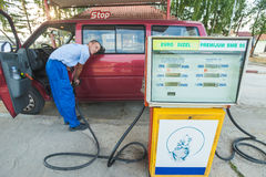 Fuelling service. BELGRADE, SERBIA - AUGUST 16: Young man refuelling on August 16, 2012 near Belgrade, Serbia. Most gas stations in the Balkan region are self Stock Images