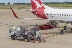 Fuelling vehicle pumping fuel into Qantas aircraft at Brisbane Airport Royalty Free Stock Image