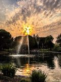 Fuente de la puesta del sol Fotos de archivo