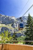 FUENTE DE,SPAIN - JULY 10, 2016: The cabin of the ropeway Teleferico Fuente De goes to mountain top. A look from the place of landing, a cabin against the royalty free stock photography