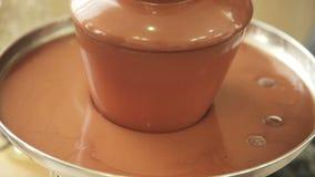 Fuente del chocolate colocada en una tabla metrajes