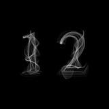 Fuente del humo Números 1 2 Imagenes de archivo