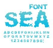 Fuente del mar Agua ABC Alfabeto de la aguamarina Letras mojadas Gota azul Fotos de archivo libres de regalías
