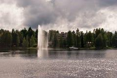 Fuente en el agua Fotos de archivo