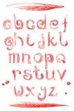 Fuente especial del chapoteo del vino rojo, letras del a-z del ABC pequeñas Fotos de archivo libres de regalías