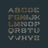 Fuente Handdrawn de sans serif con el terraplén de oro de la pendiente Imágenes de archivo libres de regalías