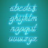 Fuente minúscula de neón azul de la escritura que brilla intensamente Fotos de archivo libres de regalías