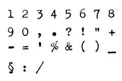 Fuente sucia - números y signos de puntuación foto de archivo