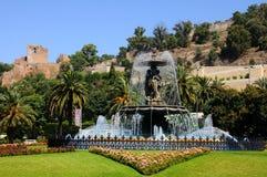 Fuente y castillo, Málaga, España. Imagenes de archivo