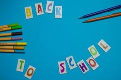 Fuentes de escuela en fondo azul - de nuevo a escuela Foto de archivo libre de regalías