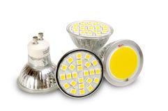 Fuentes de luz eficientes en blanco fotos de archivo
