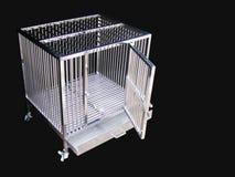 Fuentes del animal doméstico sobre la jaula inoxidable para el animal doméstico foto de archivo