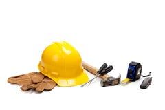 Fuentes del trabajador de construcción en blanco fotos de archivo