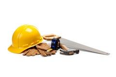Fuentes del trabajador de construcción en blanco fotografía de archivo libre de regalías
