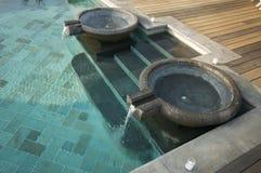 Fuentes exóticas de la piscina Fotografía de archivo