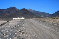Fuertaventura landscape. Scenic landscape of Fuertaventura with receding road and volcanic mountains, Canary Islands, Spain stock photo