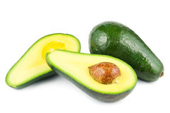 Fuerte avocados. With cross sections on white Royalty Free Stock Photo
