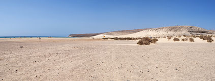 Fuerteventura, Canary Islands, Spain, Jandia, beach, Ocean, waves, nature, desert, sand, dunes, climate change, landscape. Panoramic view of Jandia beach on Royalty Free Stock Images