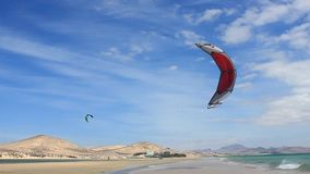 Fuerteventura - Canary Islands - September 2015 - Kitesurfer walking on a beach on Fuerteventura Canary Islands stock video footage