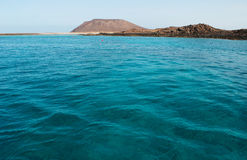 Fuerteventura, Canary Islands, Spain, Lobos island, desert, landscape, nature, climate change, Ocean, beach, water, sailing. Crystal clear water and the Caldera Royalty Free Stock Photo