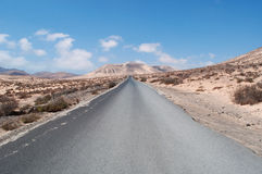 Fuerteventura, Canary Islands, Spain, Morro del jable, mountain, road, desert, landscape. The dirt road from Jandia to Morro del Jable on August 31, 2016. Morro Stock Image