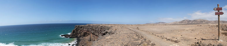 Fuerteventura, Canary Islands, Spain, dirt road, 4x4, desert, landscape, nature, climate change, mountain, panoramic, Ocean, cliff. Dirt road and signs of Royalty Free Stock Image