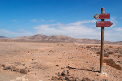 Fuerteventura, Canary Islands, Spain, sign, footpath, dirt road, landscape, desert, nature, climate change. Dirt road and signs of walking path to the beaches of Stock Image