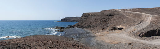 Fuerteventura, Canary islands, Spain, dirt road, 4x4, desert, landscape, nature, climate change, Pozo Negro, beach, black. The dirt road to Pozo Negro on August Stock Photography