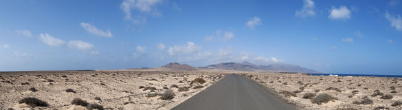 Fuerteventura, Canary Islands, Spain, Punta Jandia, mountain, dirt road, southernmost, nature, landscape, desert, climate change. The dirt road to Puerto de la Royalty Free Stock Image