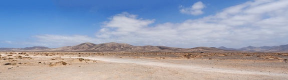 Fuerteventura, Canary Islands, Spain, dirt road, 4x4, desert, landscape, nature, climate change, mountain, panoramic, sand, dunes. The landscape seen from the Stock Image