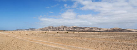 Fuerteventura, Canary Islands, Spain, dirt road, 4x4, desert, landscape, nature, climate change, mountain, panoramic. The landscape seen from the dirt road to Royalty Free Stock Photo