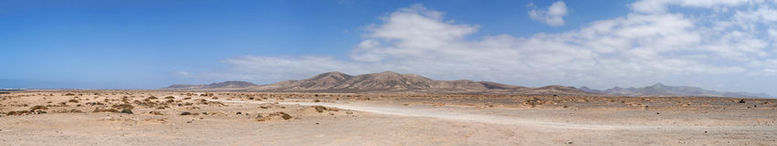Fuerteventura, Canary Islands, Spain, dirt road, 4x4, desert, landscape, nature, climate change, mountain, panoramic. The landscape seen from the dirt road to Stock Photo