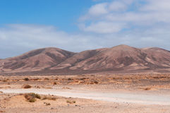 Fuerteventura, Canary Islands, Spain, desert, landscape, nature, dirt road, climate change. The landscape seen from the dirt road to the beaches of the Stock Photos