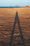 Fuerteventura, Canary Islands, Spain, Lobos island, shadow, desert, landscape, nature, dirt road, climate change. A shadow at sunset and view of Lobos on the Stock Photography
