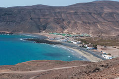 Fuerteventura, Canary Islands, Spain, Pozo Negro, desert, landscape, nature, dirt road, beach, black beach, climate change. View of the dirt road to Pozo Negro Stock Images