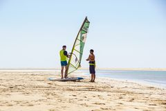Fuerteventura Island , Spain 12 June 2017 : young active man takes a windsurfing lesson with an instructor on ocean Stock Photo