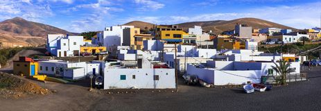 Fuerteventura - picturesque traditional fishing village Ajui, with black beach. Canary islands royalty free stock photos