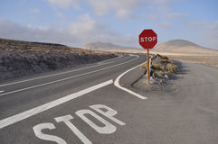Fuerteventura road 3. Car road with stop sign on the island Fuerteventura (Canary Islands Stock Photos