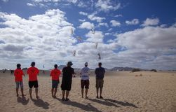FUERTEVENTURA, SPAIN - NOVEMBER 10: A group of kite enthusiast fly their kites in formation at 31th International Kite Festival,. November 10, 2018 in Nature royalty free stock photos