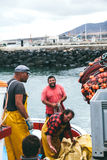 FUERTEVENTURA, SPAIN - OCTOBER 27: Fishermen unloading catch in Stock Photos