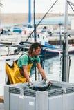 FUERTEVENTURA, SPAIN - OCTOBER 27: Fishermen unloading catch in Stock Photo