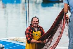 FUERTEVENTURA, SPAIN - OCTOBER 27: Fishermen unloading catch in Stock Photos