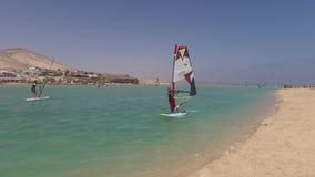 Fuerteventura: windsurfs in the lagoon of Jandia beach on September 4, 2016 stock video footage