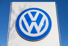 Volkswagen logo near a car dealer. FUERTH / GERMANY - FEBRUARY 25, 2018: Volkswagen logo near a car dealer. Volkswagen is a German automaker founded on 28 May Royalty Free Stock Image