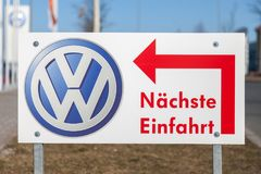 Volkswagen logo near a car dealer. FUERTH / GERMANY - FEBRUARY 25, 2018: Volkswagen logo near a car dealer. Naechste Einfahrt means next entry. Volkswagen is a Royalty Free Stock Image