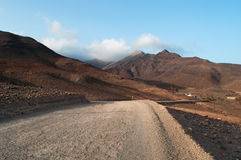 Fuerteventura, Canary Islands, Spain, dirt road, 4x4, desert, landscape, nature, climate change. The dirt road to Punta de Jandia, the extreme southern cape of Stock Image
