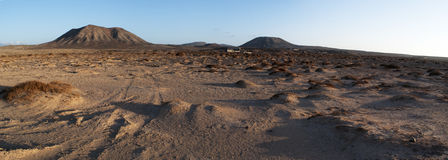 Fuerteventura, Canary Islands, Spain, desert, landscape, nature, dirt road, climate change, mountain, volcano. Mountains at sunset on the dirt road from Royalty Free Stock Photo
