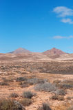 Fuerteventura, Canary Islands, Spain, mountain, red, desert, landscape, nature, climate change. View of Canary landscape with mountains and desertic land on royalty free stock photography