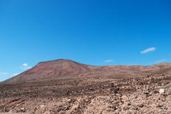 Fuerteventura, Canary Islands, Spain, mountain, red, desert, landscape, nature, climate change. View of Canary landscape with mountains and desertic land on royalty free stock images